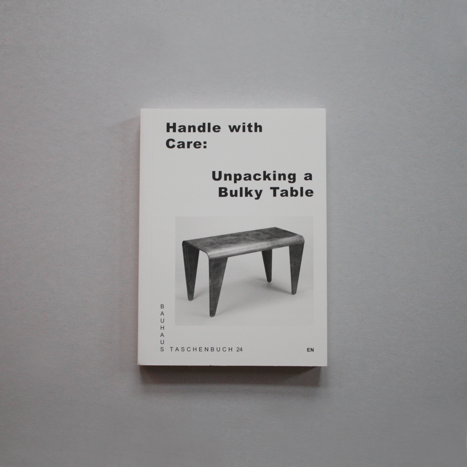 Marianna Czwojdrak Handle with Care. Unpacking a Bulky Table.